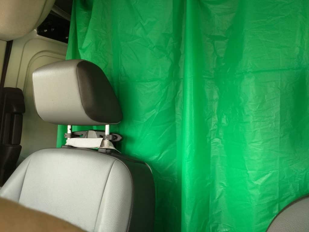 Plastic table cloth privacy curtain in van